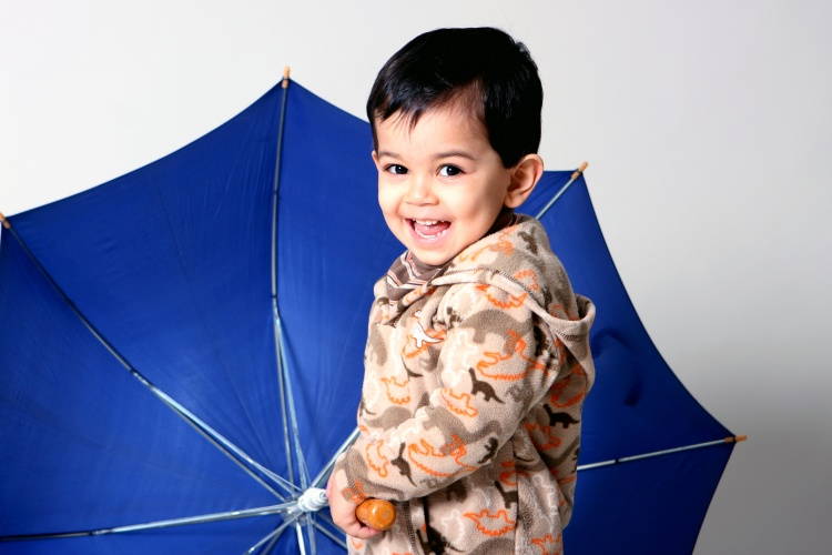 Cyrus with blue umbrella by Sharif Mohammadi
