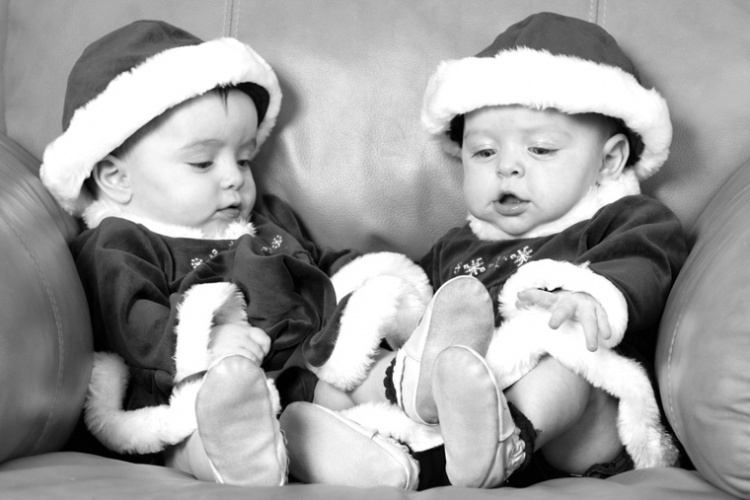 Twins in Santa uniform by Sharif Mohammadi